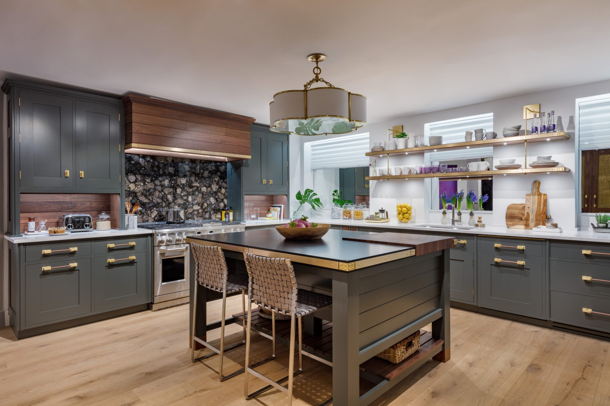 Christopher Peacockremembers the simple beauty of his childhood home through this kitchen with olive green cabinetry.