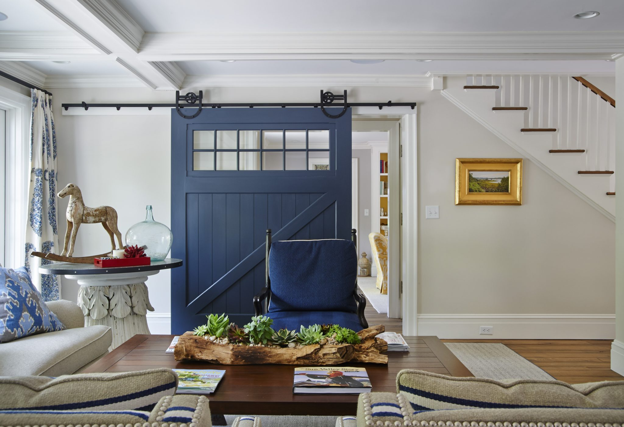 Family Room with Blue Barn Door. by Brooks & Falotico Associates, Inc.