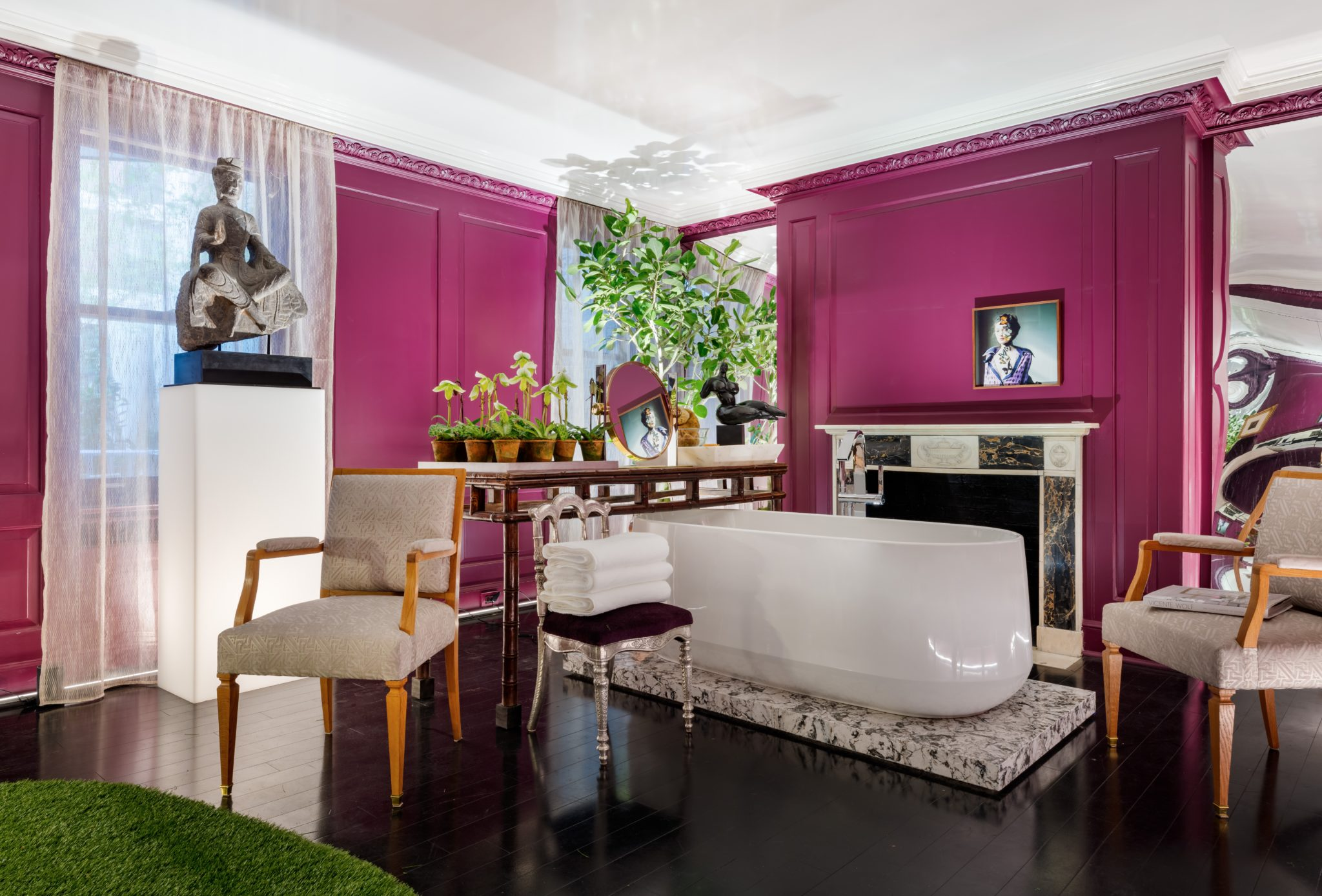 """In the """"Dreaming Room,""""Vicente Wolf Associates, designed a decadent, aubergine bathing space, in which creative accessories hone a surreal quality in the room andbacklitsheer drapesfrom The Shade Storeenhance its softness."""