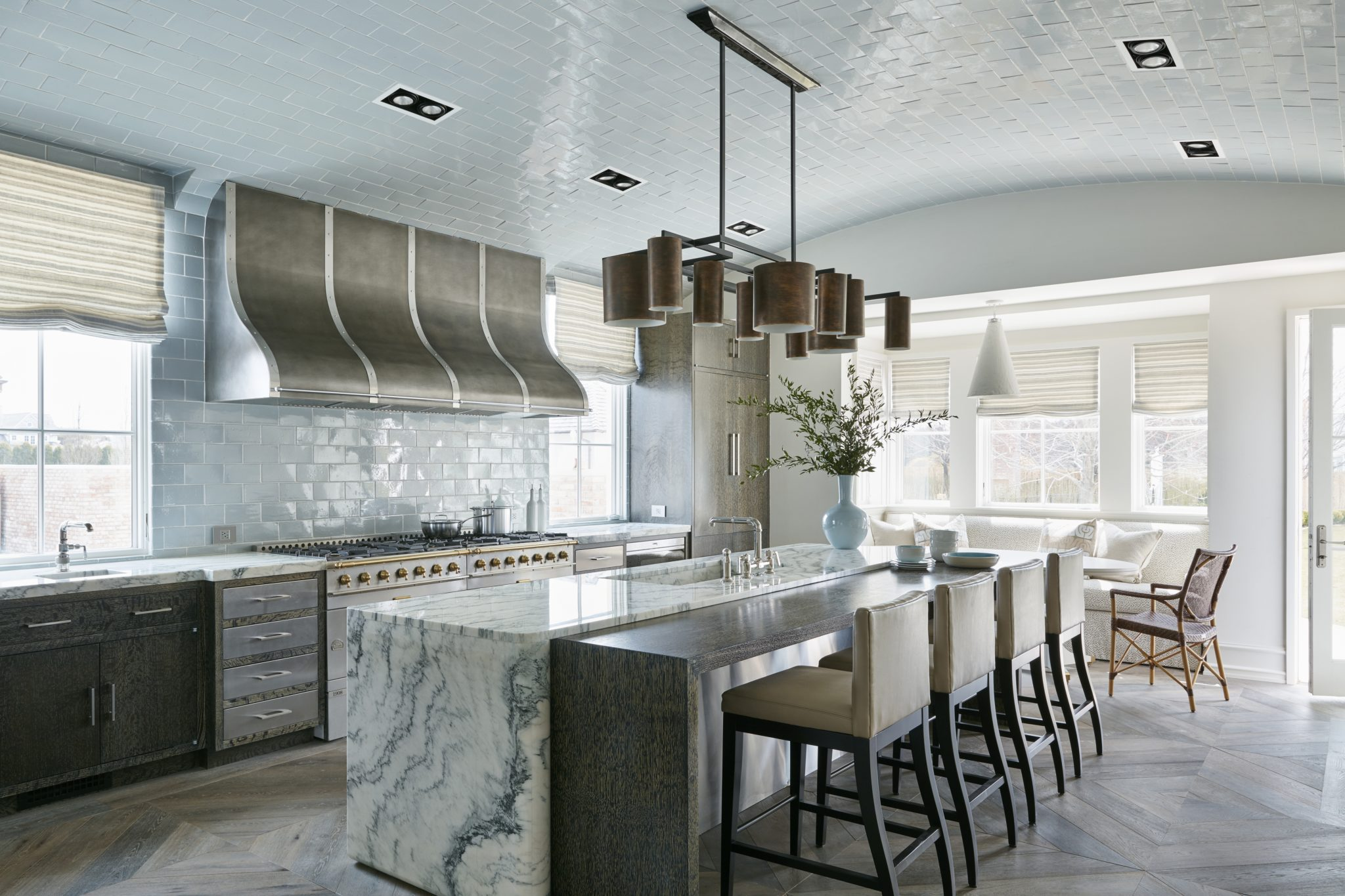An arched kitchen with striking tilework in Sagaponack, New York, by James Michael Howard