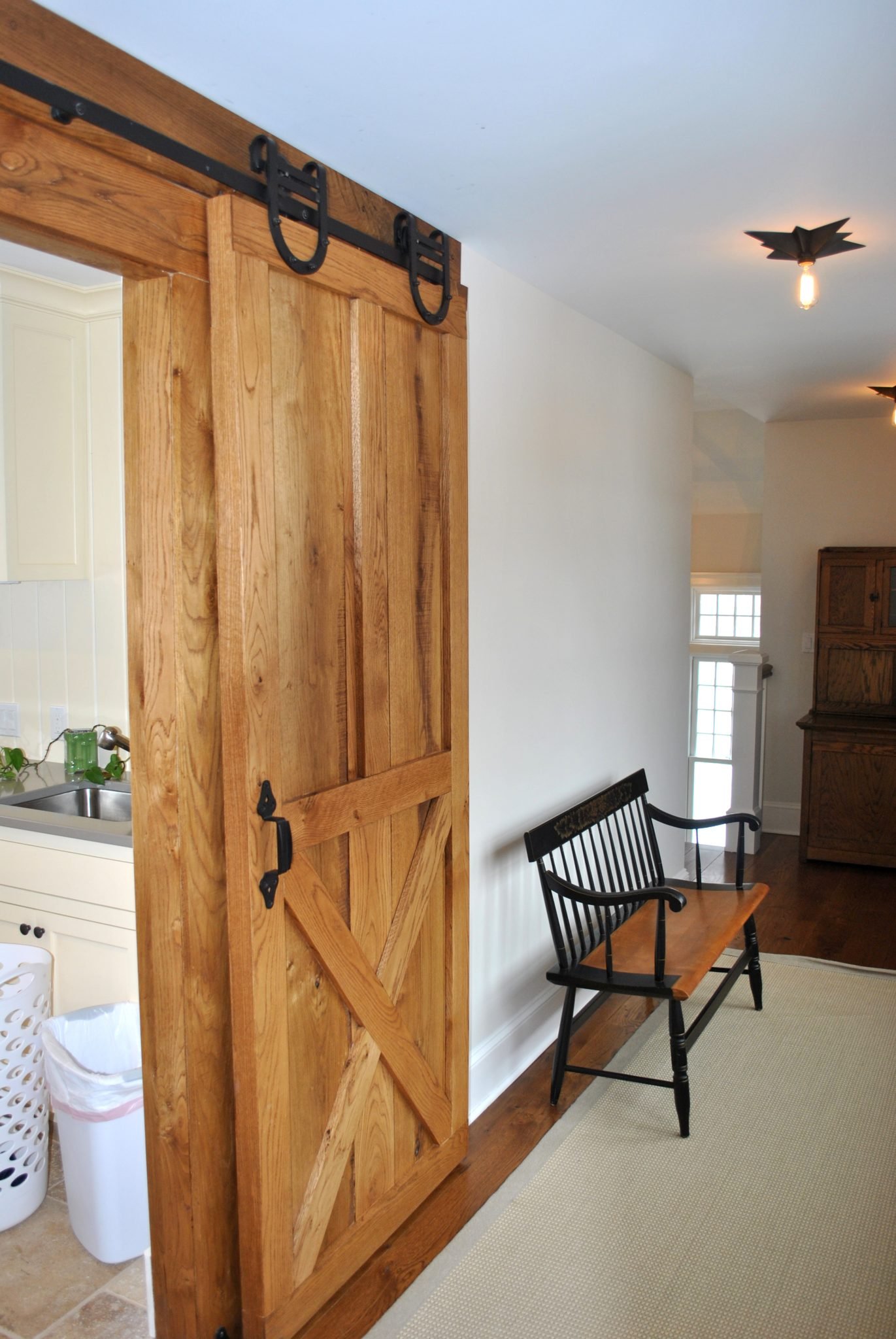 Detail of barn door at Laundry room by Huestis Tucker Architects, LLC