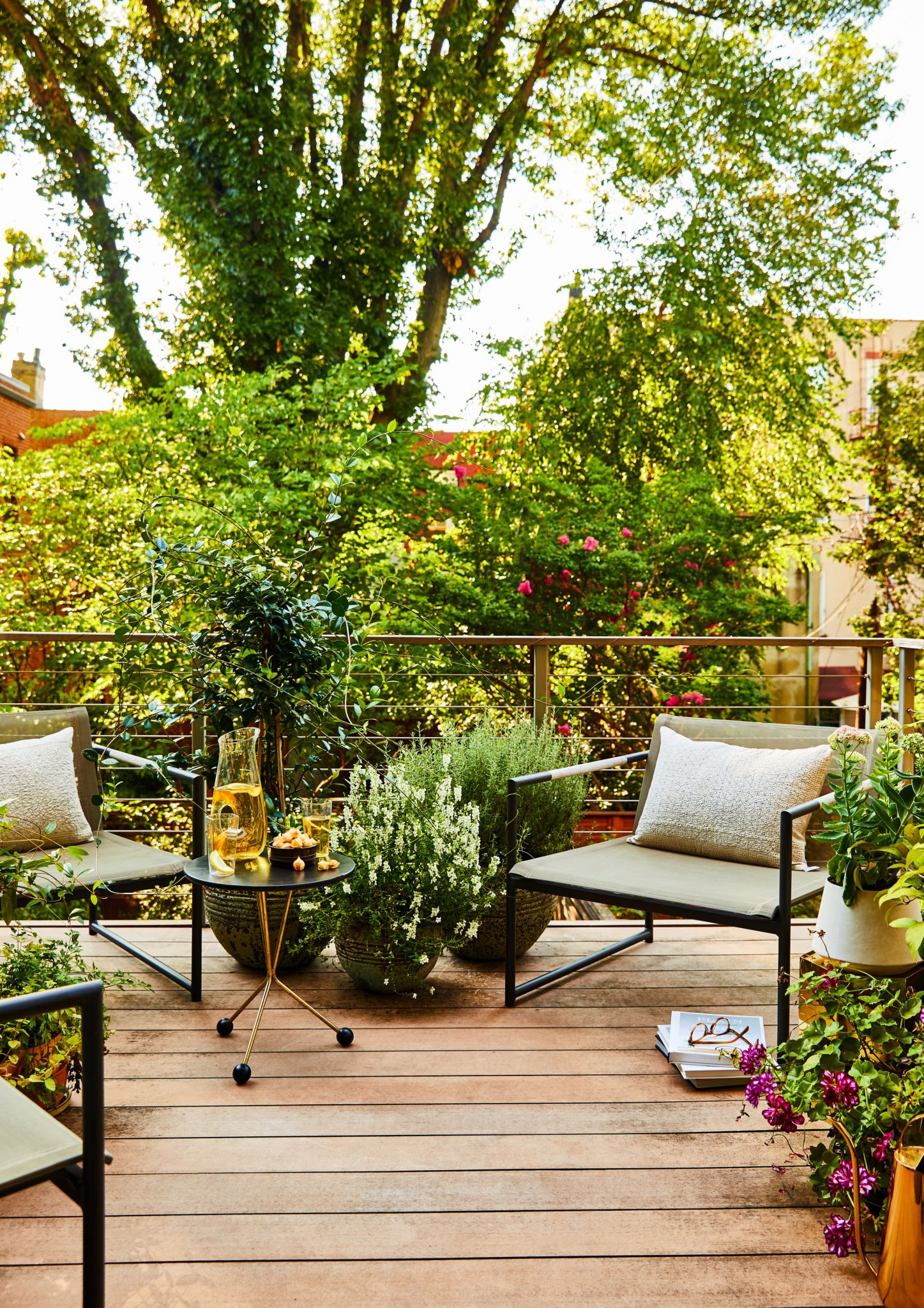 Outdoors, the designer decorated the existing balcony space overlooking the neighborhood with Wayfair chairs, a vintage side table, and custom pillows, available atJ. PATRYCE DESIGN.