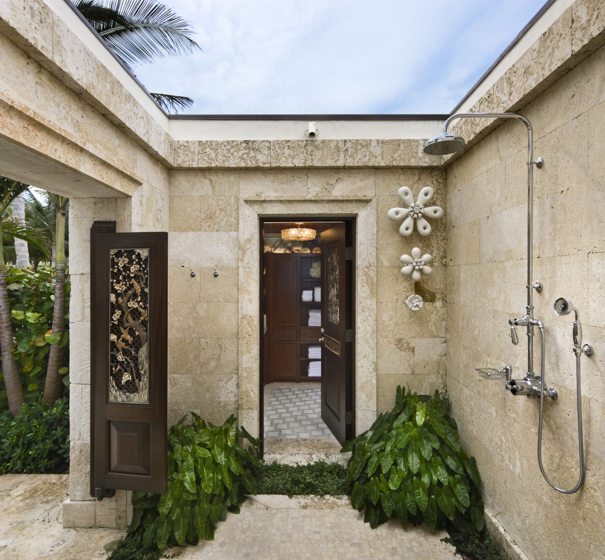 The outdoor shower of a luxe pool house, designed by Marguerite Rodgers.