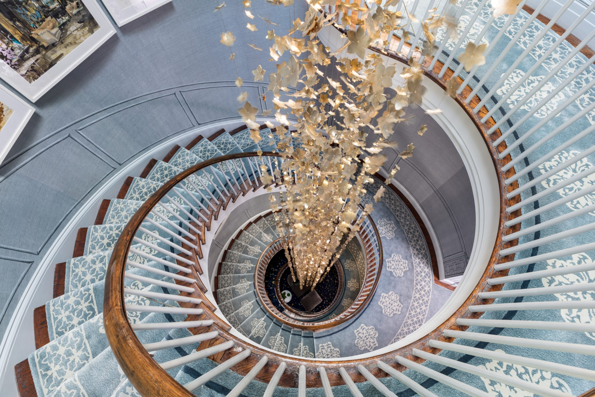 For this architectural staircase design,Gluckstein Design Planninginstalled 4,000 hand-crafted brass cherry blossoms that span four stories.