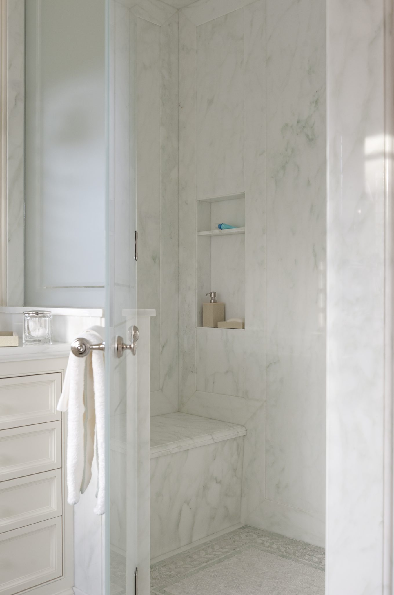 The marble for the countertops and shower walls isCalacatta Caldia, and the mosaic border on the floor is from Waterworks.