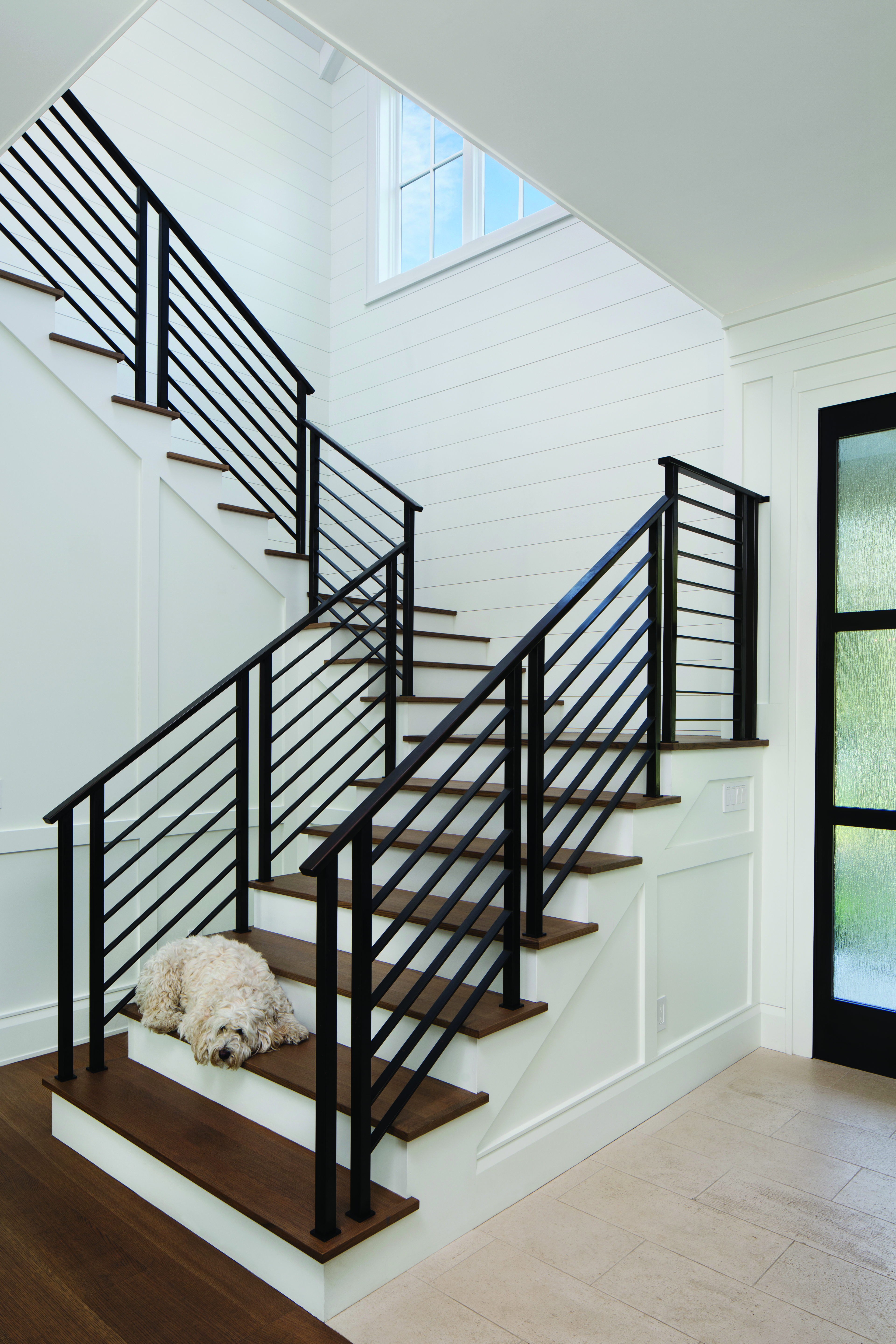 Walk up a custom staircase to discover the rest of the home.