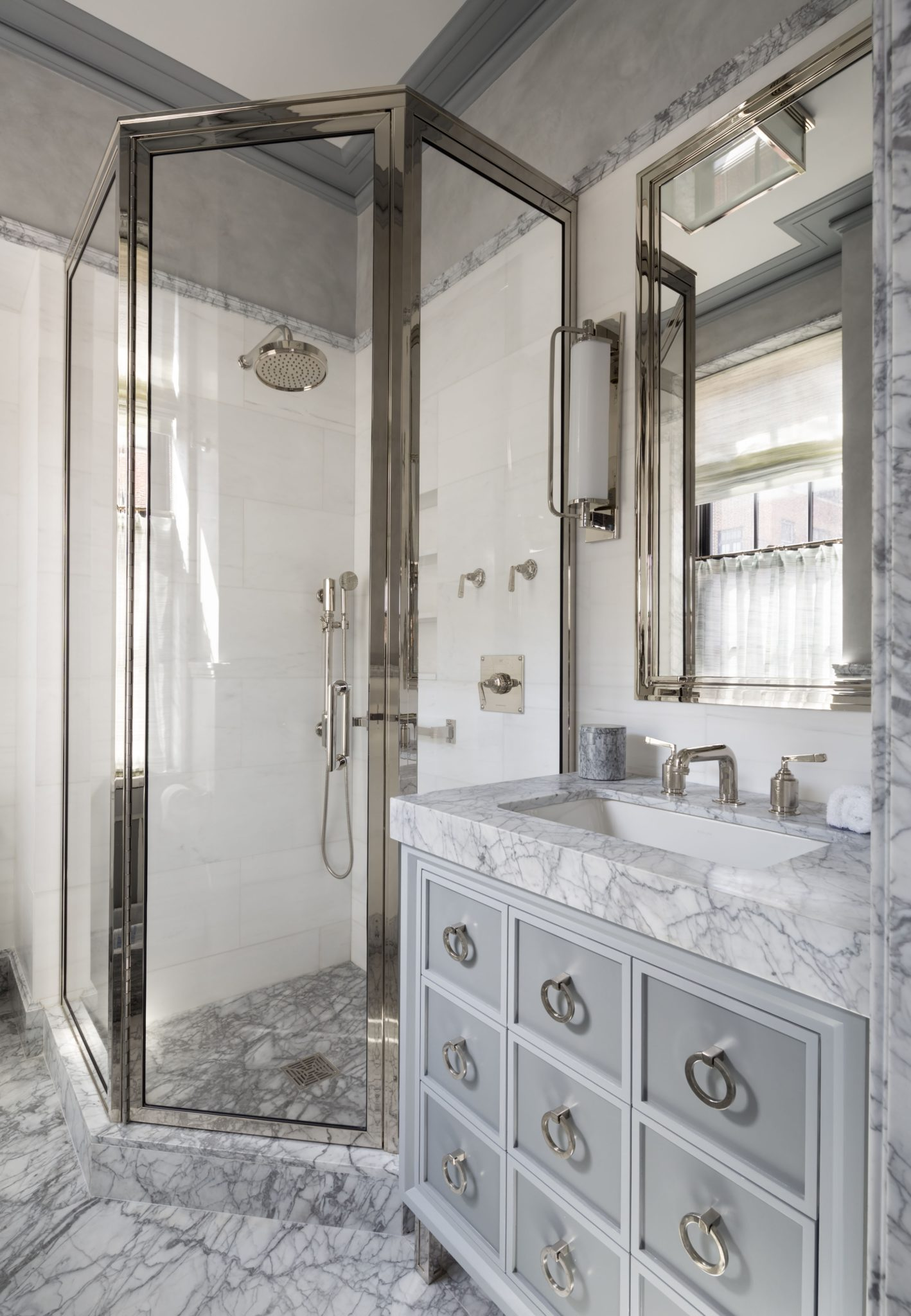 The bath off the second bedroom features a custom vanity.