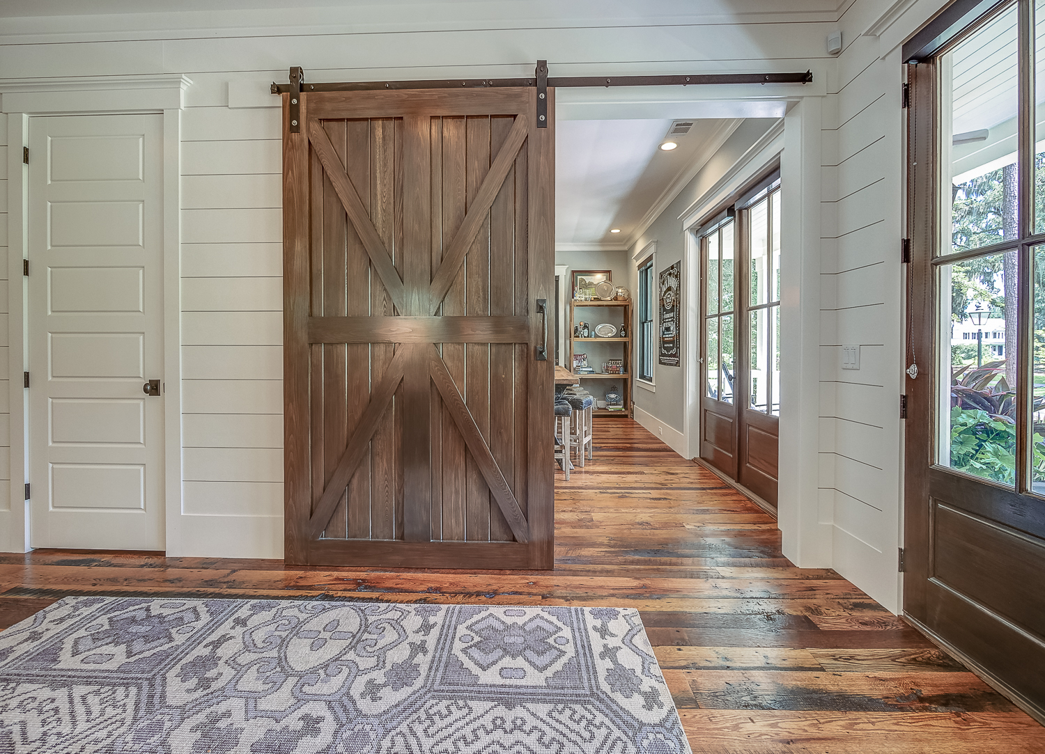Palmetto Bluff Home with Sliding Barn Door by J Banks Design