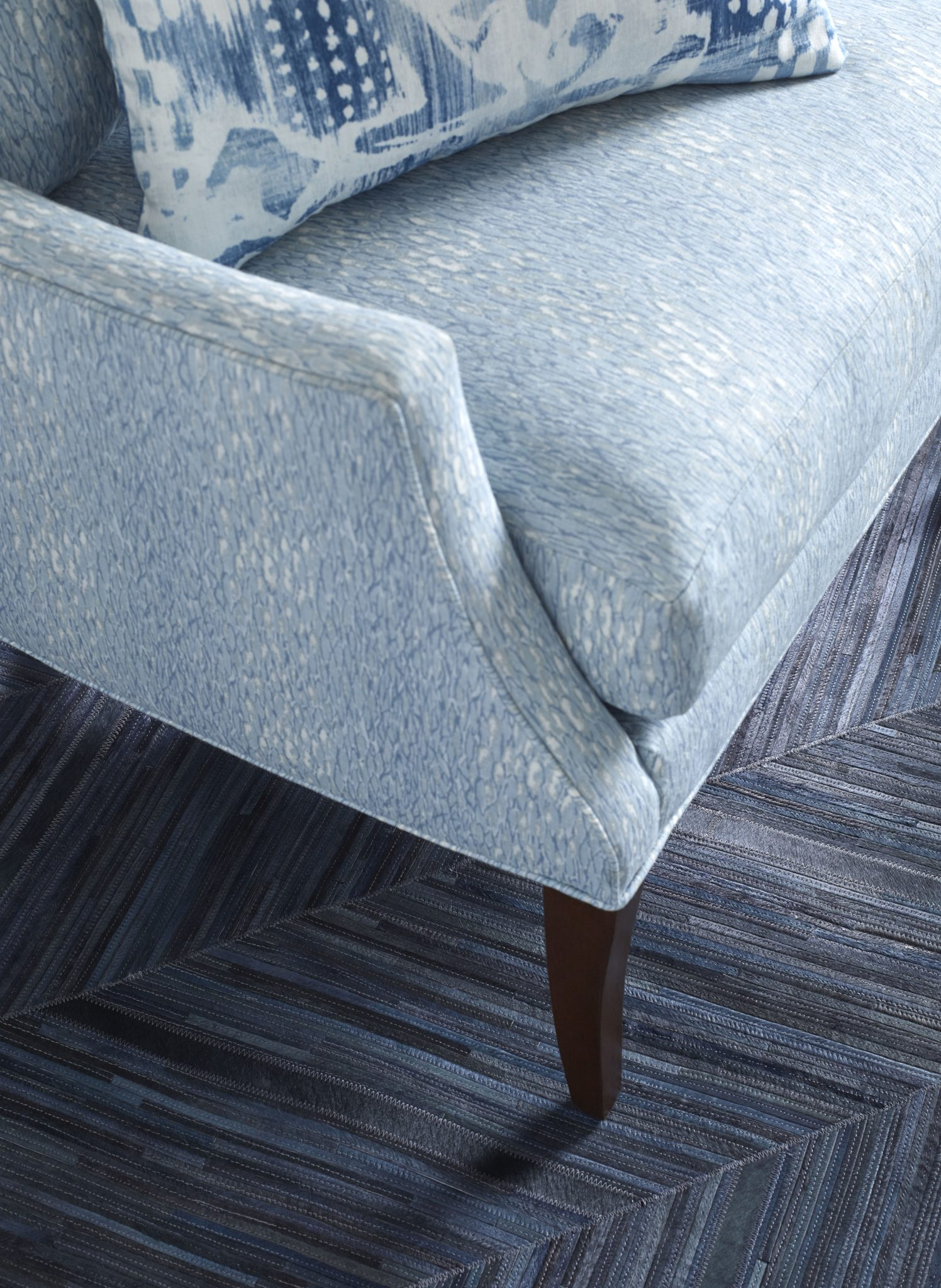 In this detail shot, the chair is covered in Chromis, while the pillow is Surfwood in Ocean.