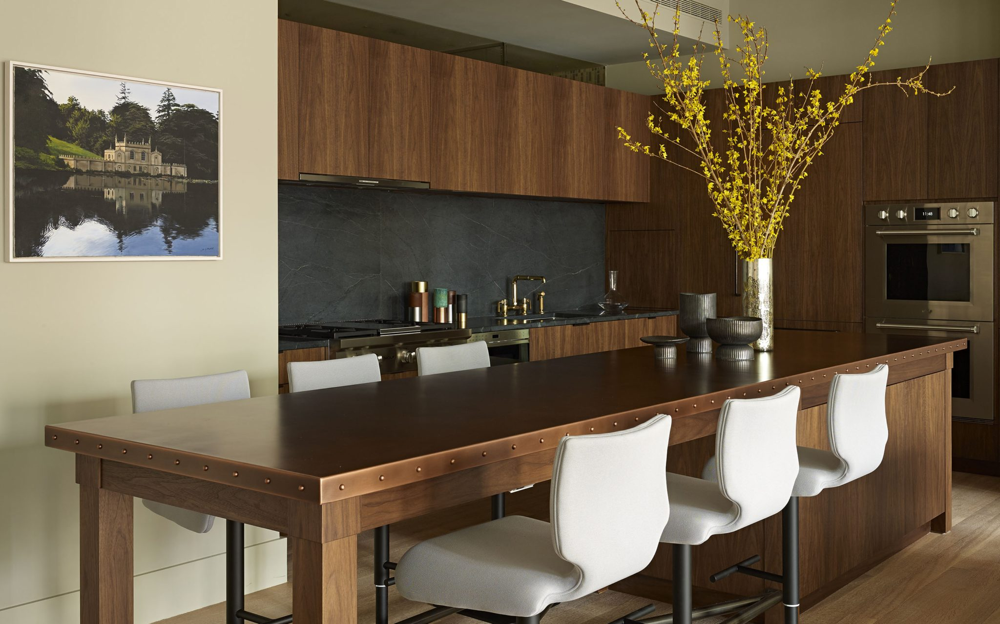 A stylish kitchen with sleek wood finishes by Frampton Co