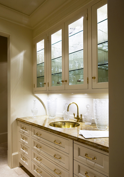 Eva Quateman designed this traditional butler's pantry with pieces by Waterworks, including the Calais One Hole Faucet.