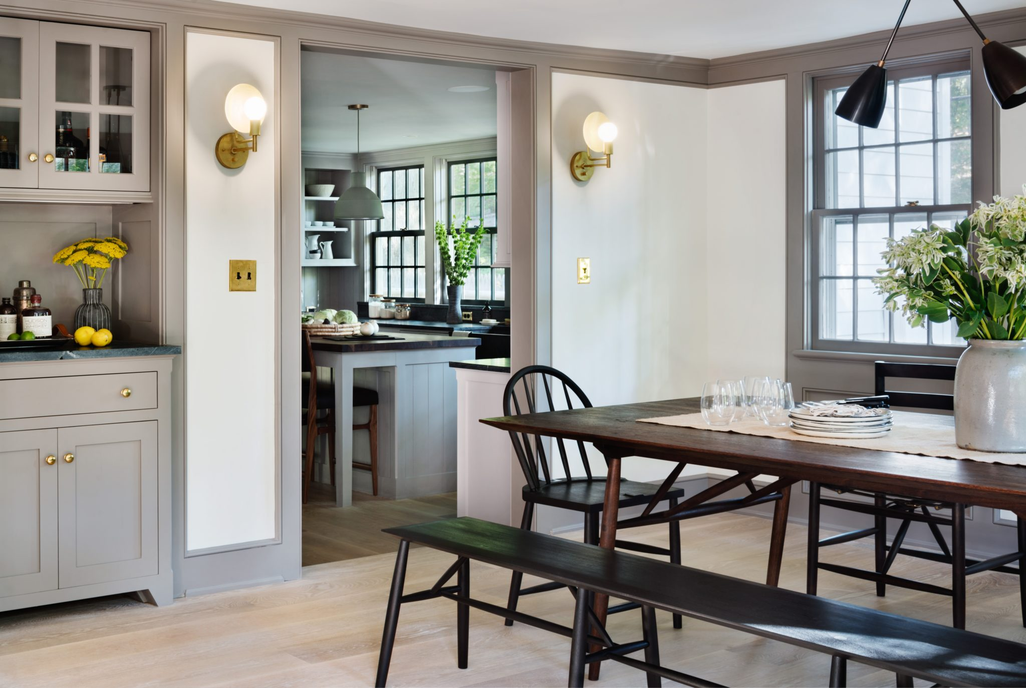 A view from the dining room into the kitchen; the sconces are by Workstead.