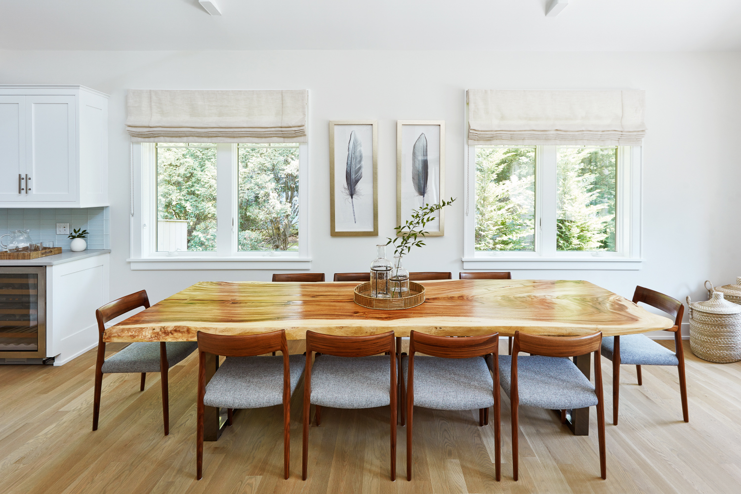 White, bright Hamptons dining room with natural wood table by Allison Garcy Interiors