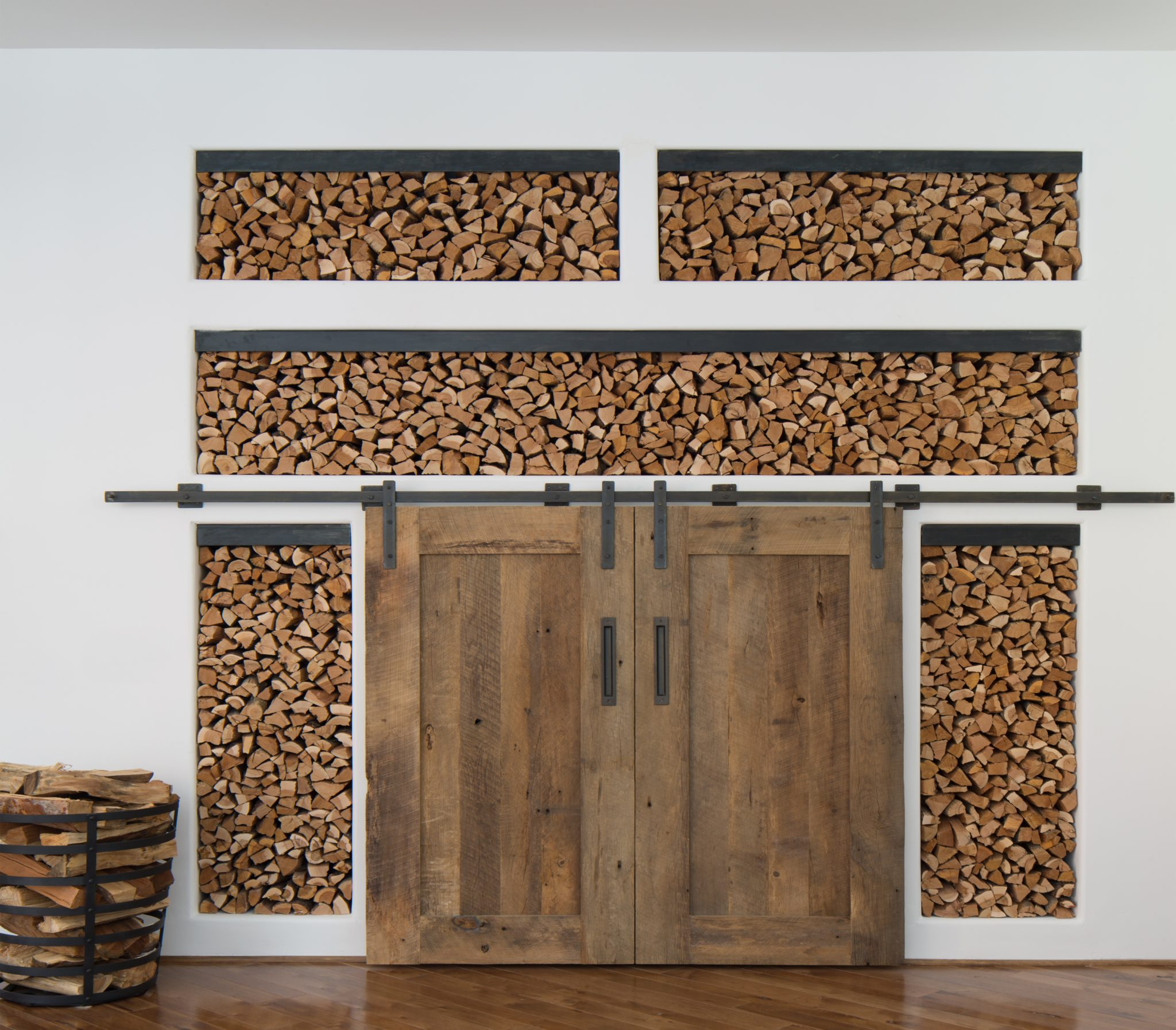 Barn doors to cover television and quarter sawn oak wood facade. by The Refined Group