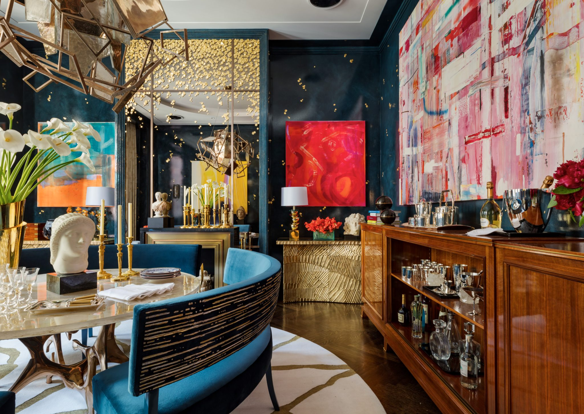 """Called """"Rhapsody in Blue,"""" this deep bluelacquered dining roomfromCullman & Kravis, Inc.with Douglas C. Wright Architectsfeatures gold embellishments, vintage and custom-made furniture, andbold contemporary art."""