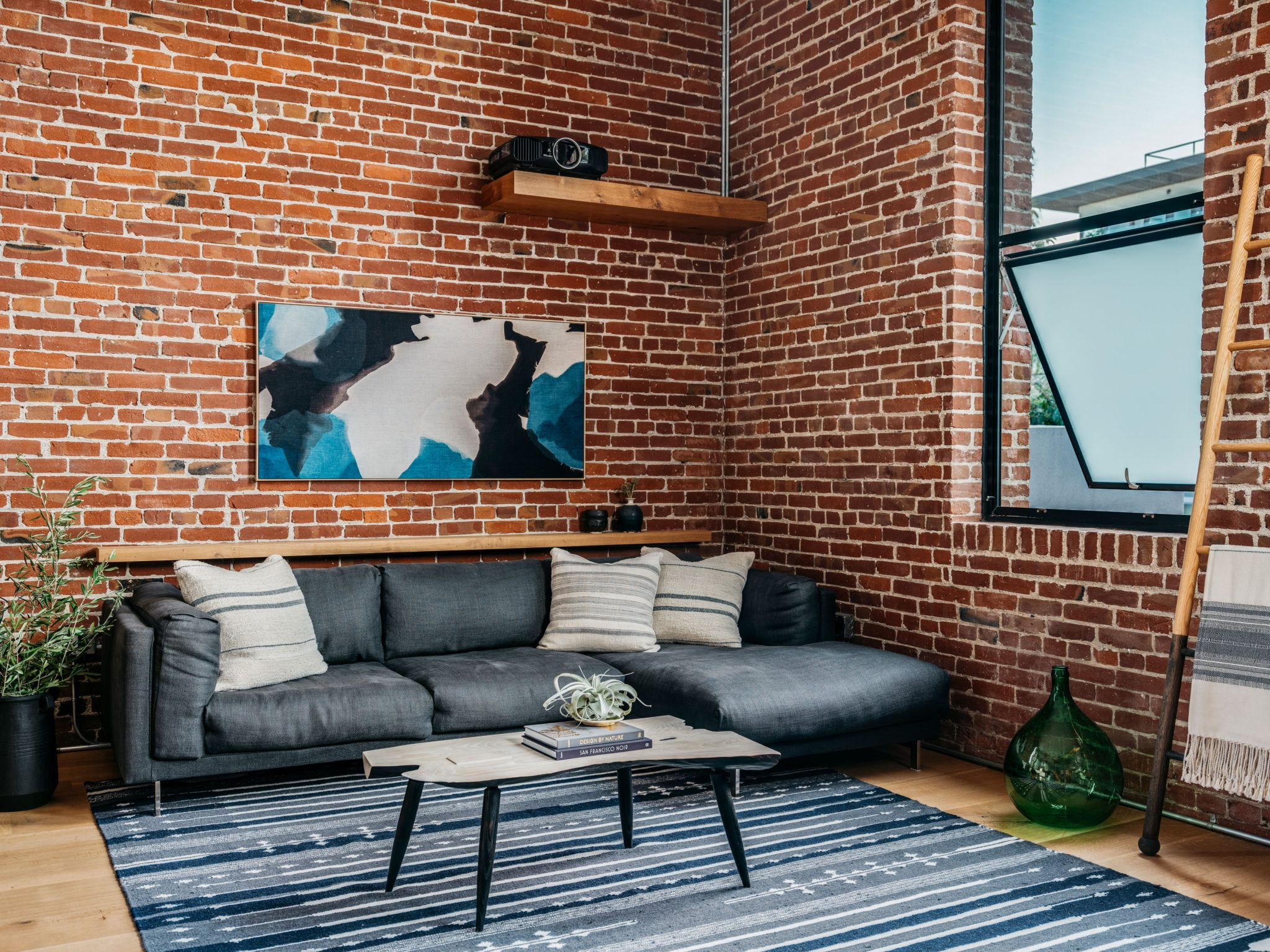 Cozy elements offset the industrial archtiecture of the space.