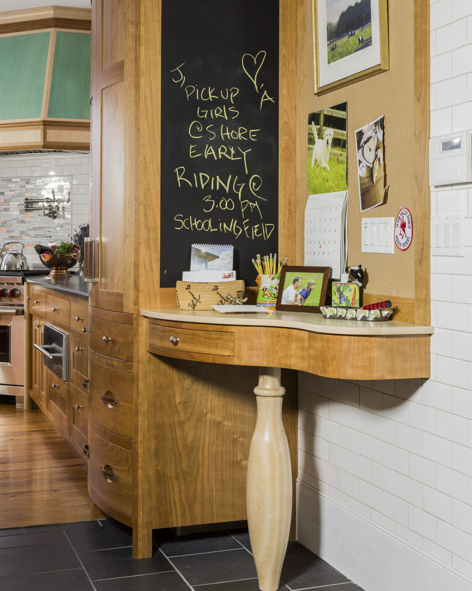 Blackboard message center desk in New England farmhouse kitchen. by Kathy Marshall Design