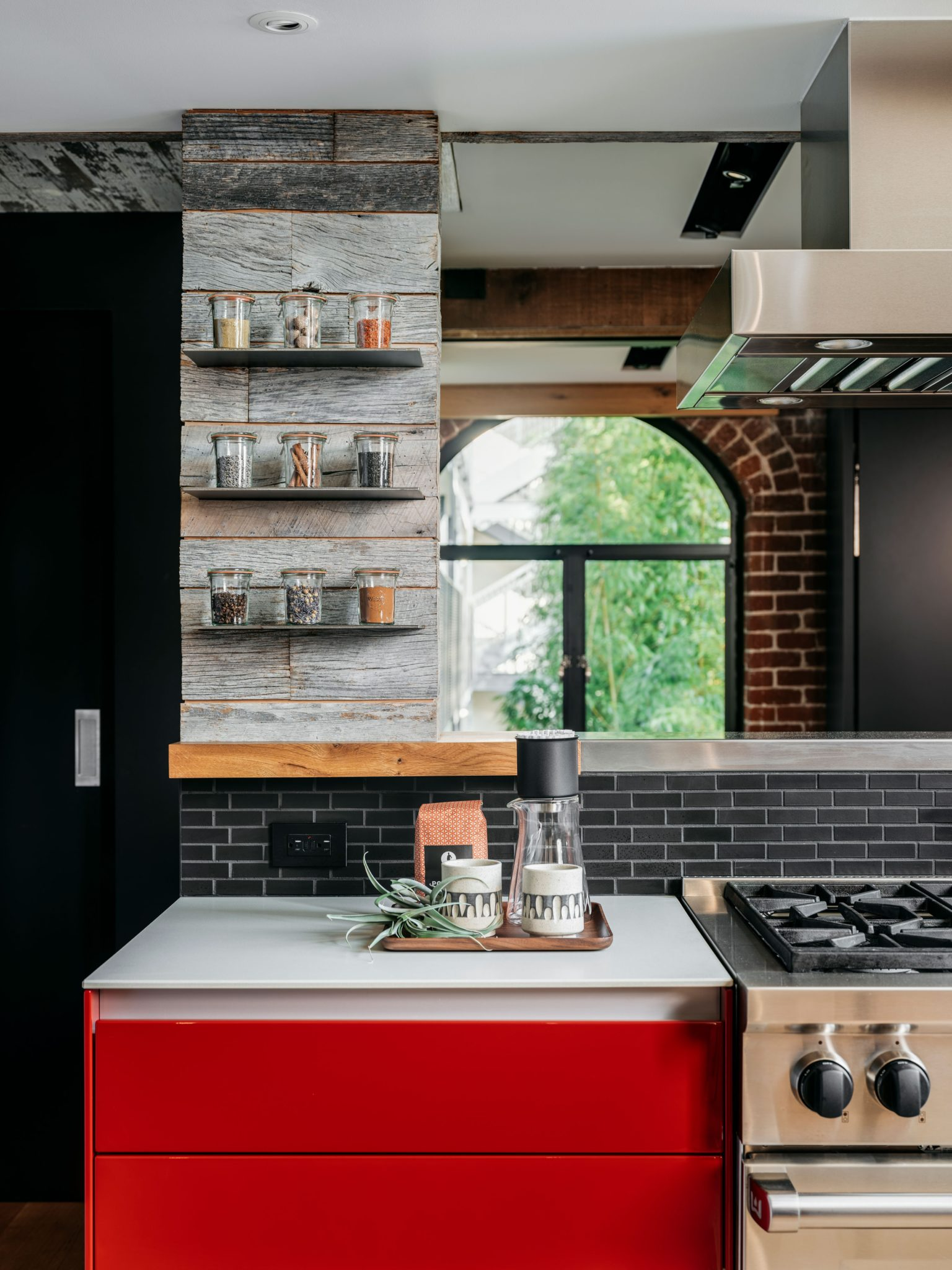 Mixed materials give the kitchen an eclectic personality. The tile backsplash here is from Heath Ceramics.