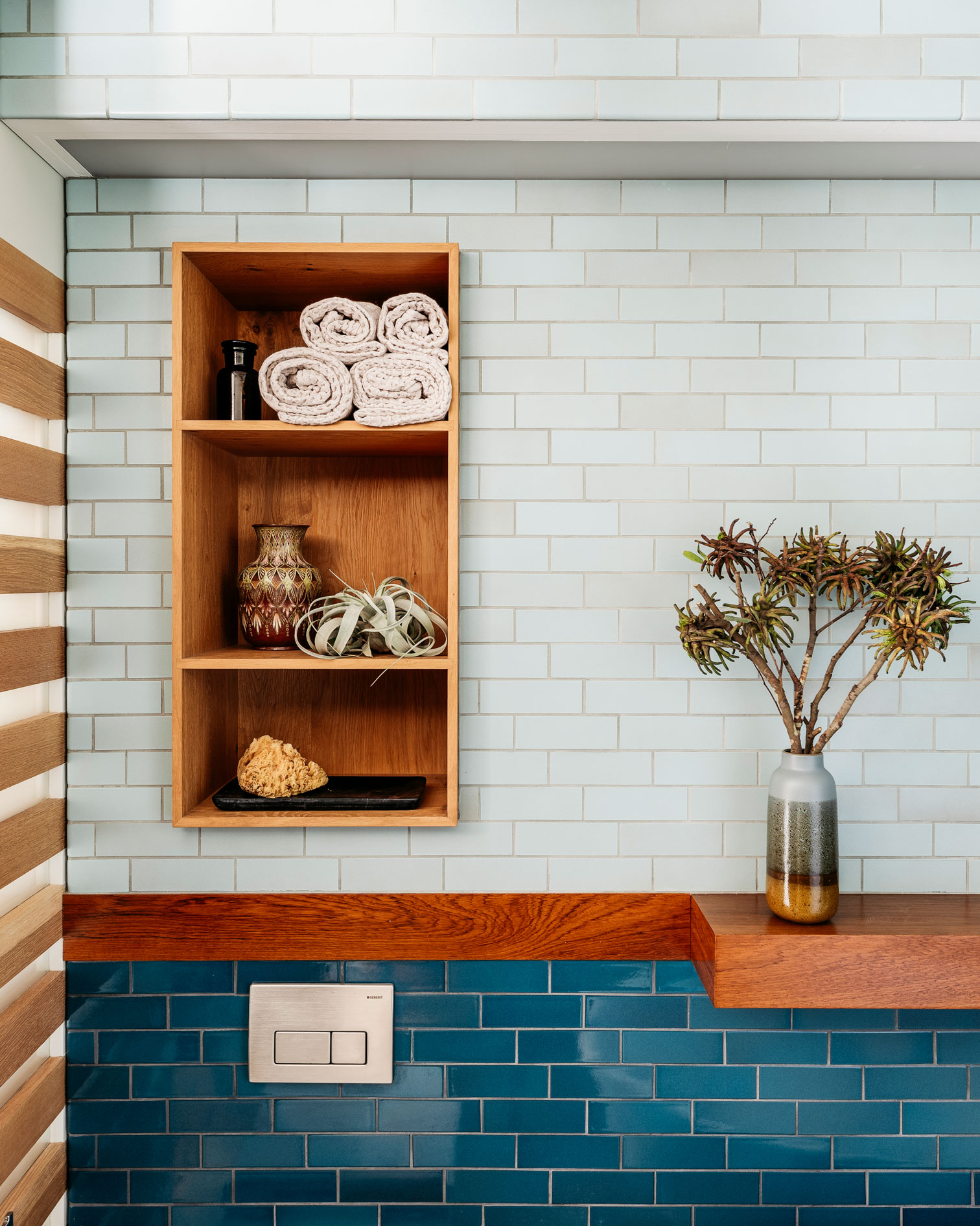 Murdock designed niches throughout the space for storage and decorative purposes.