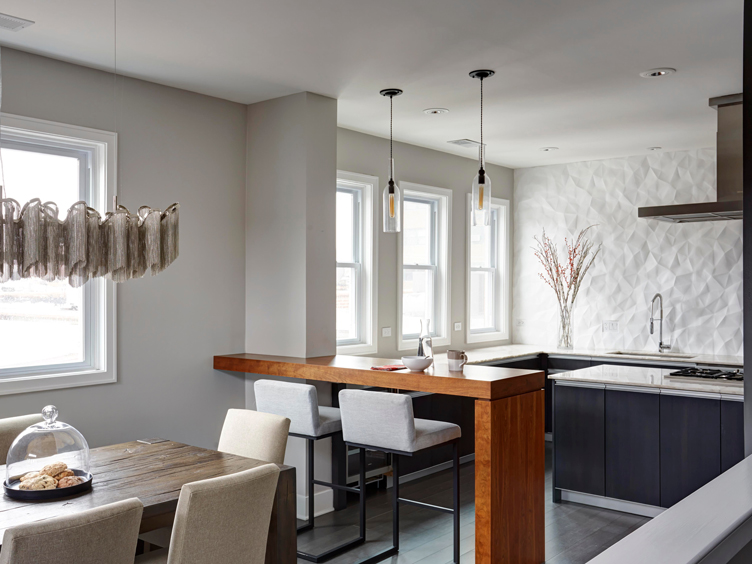 This image has an empty alt attribute; its file name is modern-condo-open-dining-breakfast-bar-and-kitchen-gray-white-with-feature-wall-9723.jpg