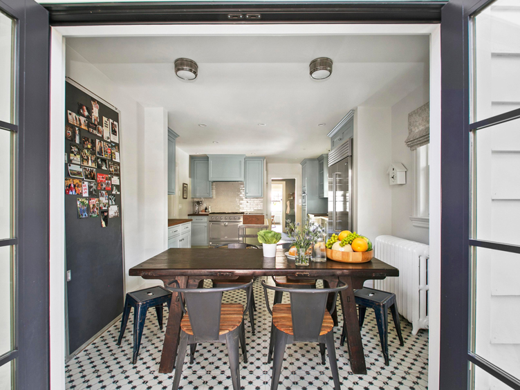 This image has an empty alt attribute; its file name is north-end-boise-kitchen-dining-area-vintage-metal-stools-table-and-chalkboard-5290.jpg