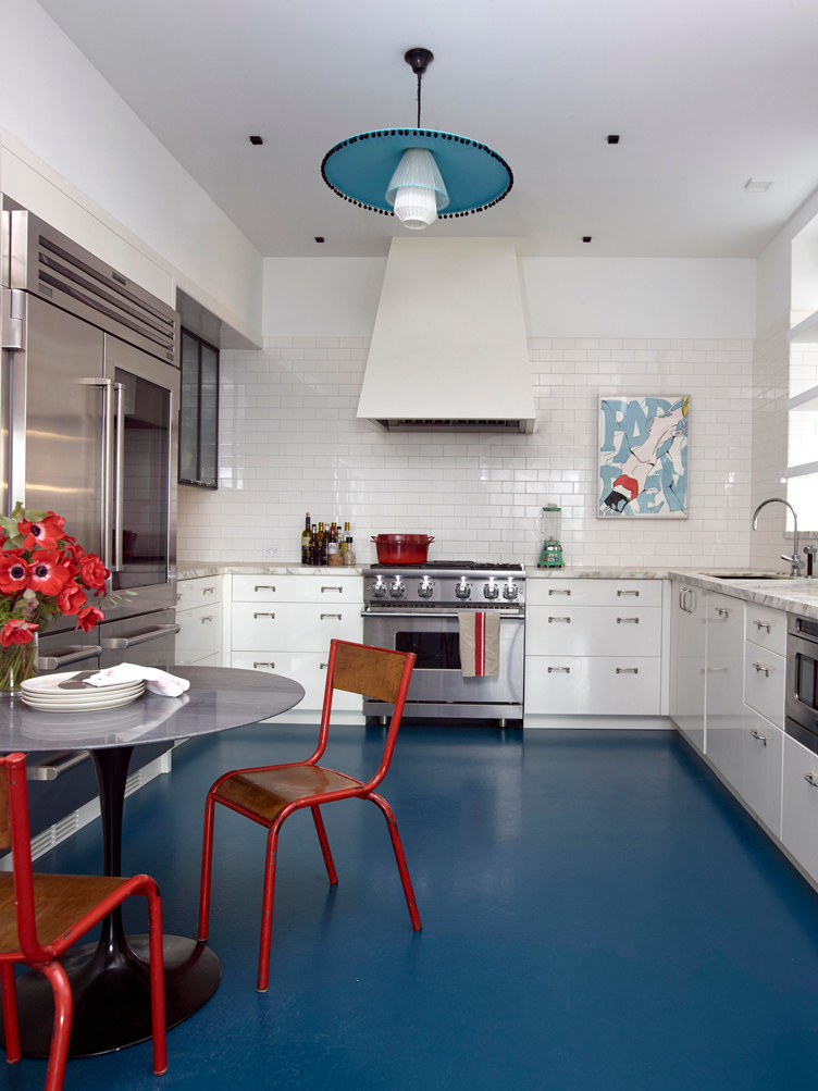 This image has an empty alt attribute; its file name is central-park-apartment-white-tile-kitchen-blue-con.jpg